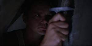 Screenshot of Andy Dufresne (played by Tim Robbins) using his rock hammer in The Shawshank Redemption (source: Castle Rock Entertainment).