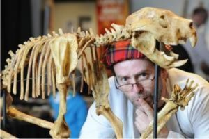 Professor Flint with a skeleton of the Marsupial 'Lion'